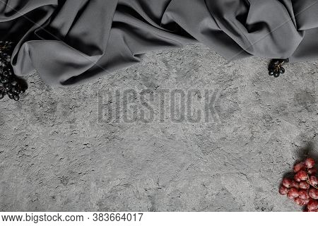 Grape on gray background. Top view, overhead. Concrete and cloth background