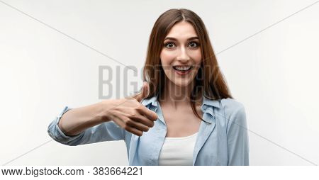 Happy Caucasian Young Female With Long Chestnut Hair, Dressed In Casual Clothes, Shows Okay Sign Wit