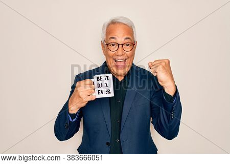 Middle age senior grey-haired man drinking a coffee on best dad cup over isolated background screaming proud and celebrating victory and success very excited, cheering emotion
