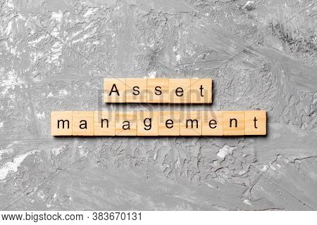 Asset Management Word Written On Wood Block. Asset Management Text On Table, Concept