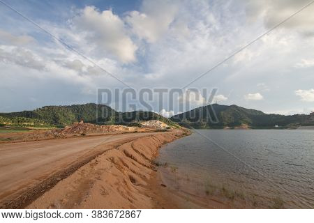 Mengkuang Dam With A Yellow Soil Path During Expansion Of The Dam.