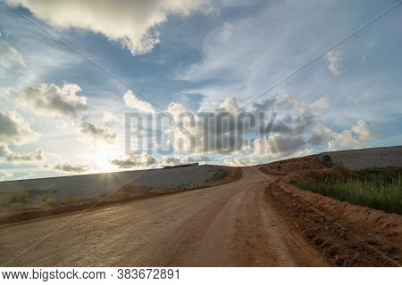 Yellow Land With Sunset With Cloudy Sky.