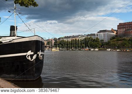 An Old Steam Boat Is Standing At The Harbor Of Helsinki, The Capital Of Finland, On A Summer Day. A