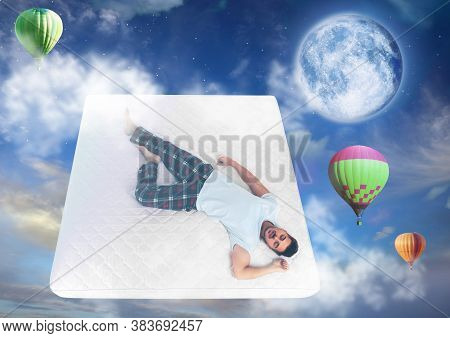 Sweet Dreams. Blue Cloudy Sky With Full Moon And Hot Air Balloons Around Sleeping Young Man