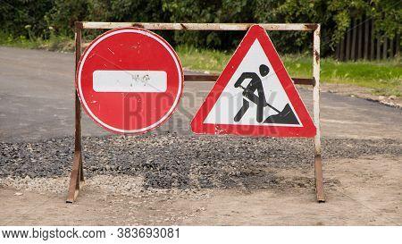 Road Sign On The Road. Work Repair Sign. Repair Of Roads. To Make Asphalt. Road Ahead Closed And Div