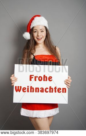 Frohe Weihnachten - Female Santa Wishing Merry Christmas In German