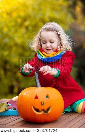 Child Carving Halloween Pumpkin. Kids Carve Pumpkins For Trick Or Treat Jack O Lantern. Autumn Activ
