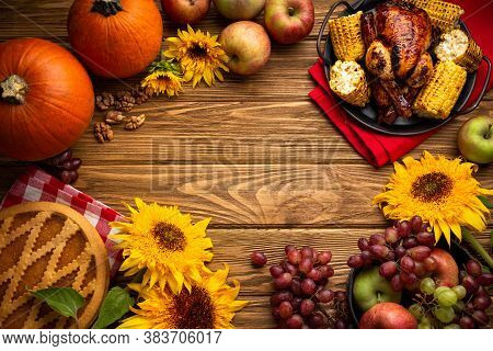Thanksgiving Festive Table Composition With Roasted Turkey, Pumpkin Pie, Autumn Fruit. Thanksgiving