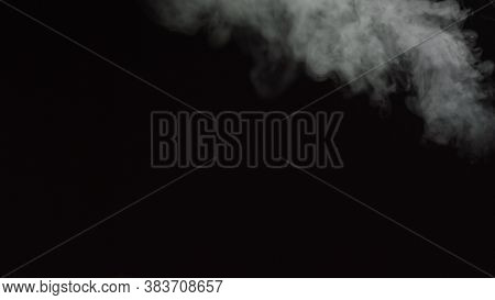 White Water Vapour On A Black Background. Close-up Shot. White Fume Slowly Floating Rises Up. Abstra