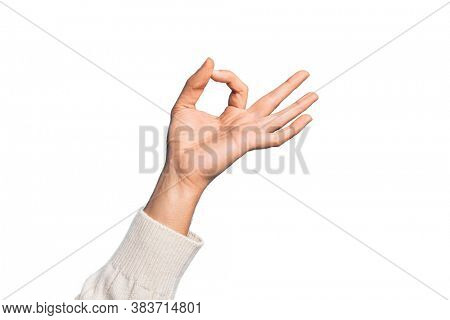 Hand of caucasian young man showing fingers over isolated white background gesturing approval expression doing okay symbol with fingers