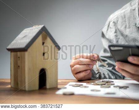 Man Checking Bills From Smart Phone And Having Financial Problems With Home Debt, Money Concept., Re