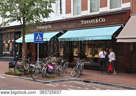 Amsterdam, Netherlands - July 10, 2017: People Visit Tiffany & Co Fashion Shop At P.c. Hooftstraat I