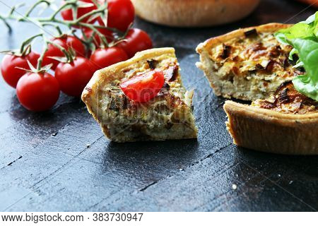 Savory Mini Quiches Or Tarts On A Rustic Board. Flaky Dough Pies. Fresh Basil And Tomatoes On Handma