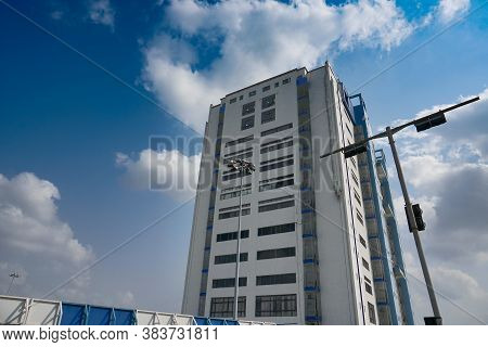 Howrah, West Bengal,India - May 23rd 2020 : Nabanna, building in Howrah, houses the State Secretariat of West Bengal with blue cloudy sky. Office of the respected Chief Minister, Smt. Mamata Banerjee.