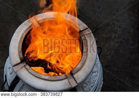 Firewood Is Burned In A Tandoor Heating It Before Cooking Meat. Evening In The Garden. Tandoor Oven