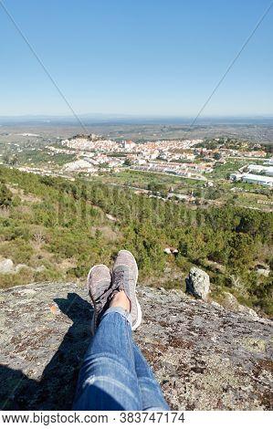 Woman Feet At Nature Landscape In Serra De Sao Mamede Mountains With Castelo De Vide City On The Bac