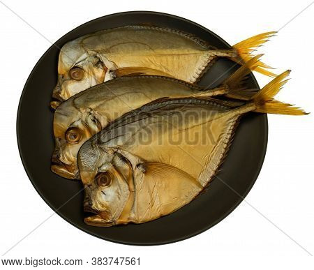 Three Smoked Vomer Fish On A Plate Isolated On White