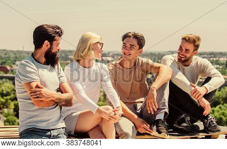 Family Traditions. Diverse Young People Talking Together. Happy Men And Girl Relax. Group Of Four Pe