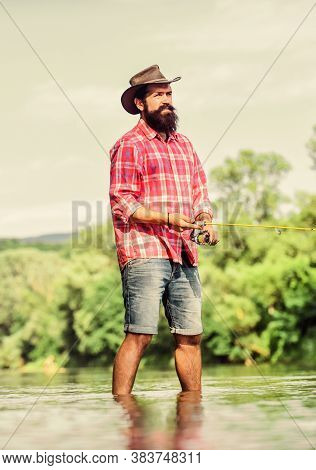 Gain Passion With Hobby. Sport Activity And Hobby. Experienced Fisher In Water. Successful Fly Fishi