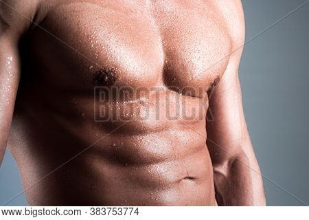 Bare Torso Of Muscular Man. Muscular Model Brutal Guy. Sexy Gay Flexing His Muscles