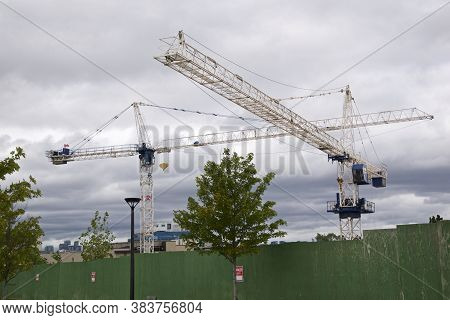Cranes Over The Condominium Construction Site, Toronto, Ontario, Canada.