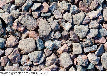 Background Of Stony Pebbles. Small Stones Of The Sea Beach. Texture Of Sea Pebble Stones Close Up
