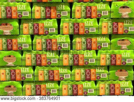 San Leandro, Ca - Aug 27, 2020: Warehouse Pallet Stacked With Cases Of Izze Sparkling Juice In Peach
