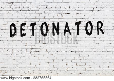 White Brick Wall With Inscription Detonator Handwritten With Black Paint