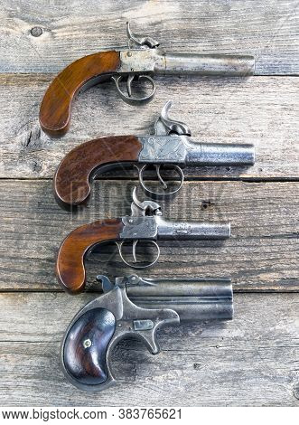 Antique Derringer Style Pistols Made From 1840-1865.