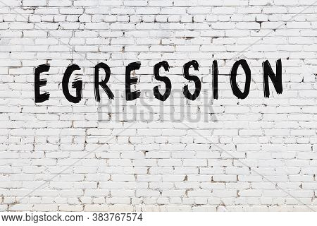 Inscription Egression Written With Black Paint On White Brick Wall.