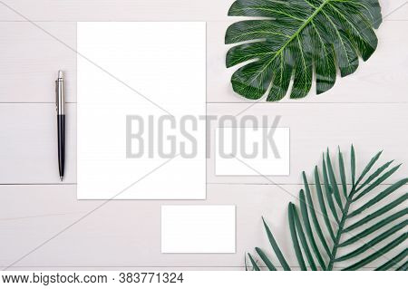 Blank Paper Sheet And Name Card Mockup With Copy Space And Leaf On Wooden Table, Poster And Invitati