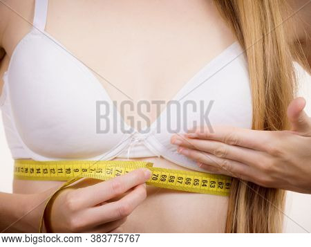 Young Slim Woman Wearing Bra With Measure Tape Measuring Her Chest Under Breast. Bosom, Brafitting A