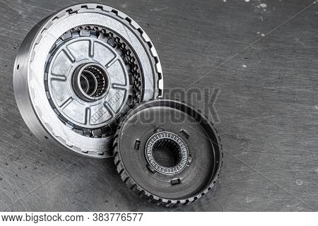 Engine And Gearbox Spare Parts. Shiny Gears For Planetary Gearbox.metal  Autotechnology Background.