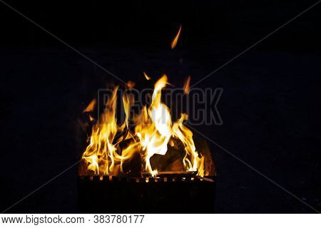 Fire On A Dark Background. Fire From Firewood Close Up. Flaming Burning Sparks Close-up, Fire Patter