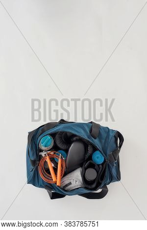 Gym Equipment And Accesirises. Vertical Shot Of Sports Bag With Boxing Gloves, Hand Wraps, Sport Clo