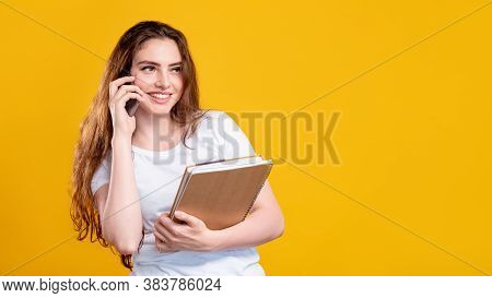 Business Call. Advertising Background. Portrait Of Cheerful Happy Woman In White With Notebooks Talk