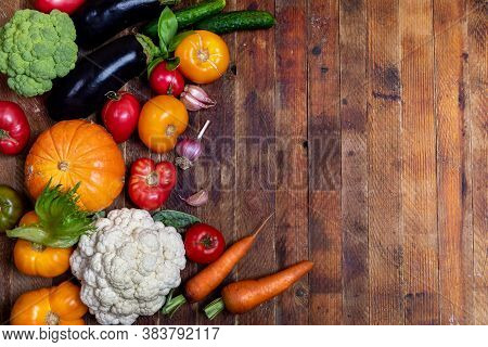 Harvest Of Fresh Farm Vegetables On Old Rustic Weathered Vintage Wooden Table. View Above. Copy Spac