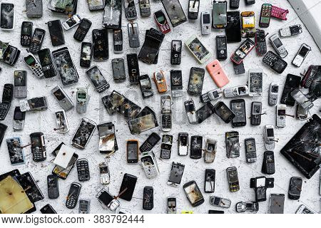 Mobile Phones Are Nailed To The Wall.