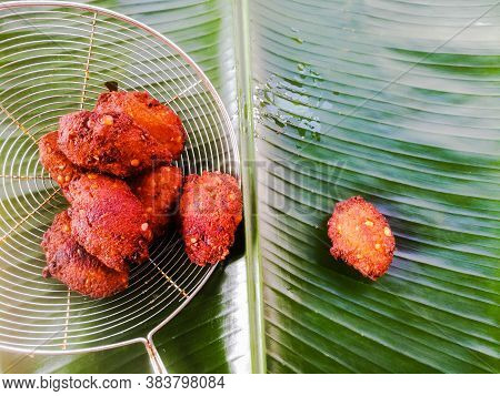 Fried Parippu Vada Placed In A Banana Leaf In Traditional Fashion.it Is Actually Made Of Dal Or Peas