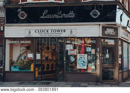 London, Uk - August 20, 2020: Exterior Of Clock Tower Launderette And Dry Cleaners In Crouch End, An