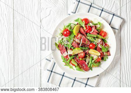 Beef Steak Salad Of Sliced Sirloin Steak With Arugula, Cherry Tomatoes, Green Beans, Shredded Parmes