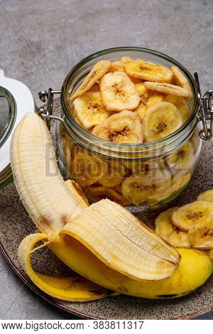 Healthy Snack, Crispy Dehydrated Unsugared Banana Chips In Glass Jar