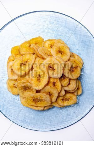 Healthy Snack, Crispy Dehydrated Unsugared Banana Chips On Recycled Glass Plate On White Background