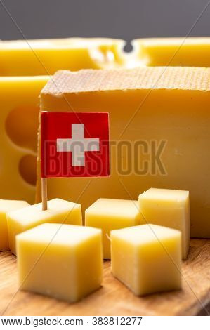 Swiss Cheeses, Block Of Medium-hard Yellow Cheese Emmental Or Emmentaler With Round Holes And Mature