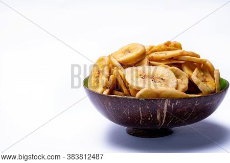 Healthy Snack, Crispy Dehydrated Unsugared Banana Chips In Bowl On White Background