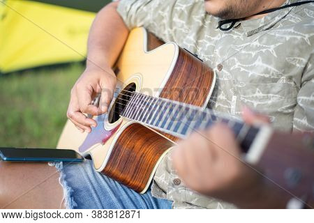 Man Playing Acoustic Guitar, Focus On Acoustic Guitar Body, Close-up