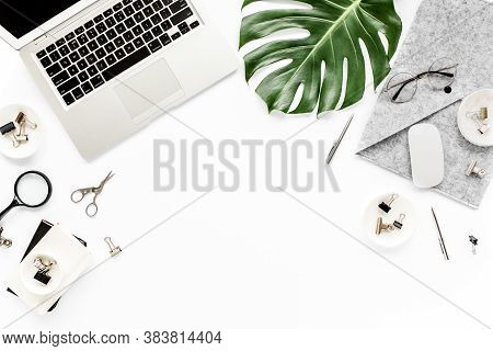 Home Office Workspace Mockup With Laptop, Tropical Leaves Monstera, Clipboard, Notebook And Accessor