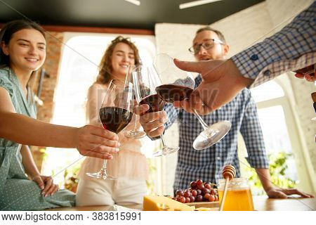 Good Vibes. People Clinking Glasses With Wine Or Champagne. Happy Cheerful Friends Celebrate Holiday