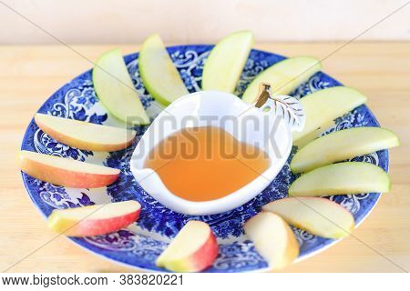 Jewish Holiday Rosh Hashana Background With Honey And Slices Of Apple On Wooden Table. During The Je