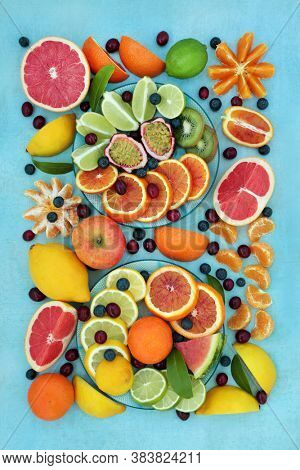 Winter sunshine healthy fruit collection with cranberries, blueberries, oranges, lemons, limes & grapefruit high in antioxidants, anthocyanins, fibre & vitamin c. Immune boosting health care concept.